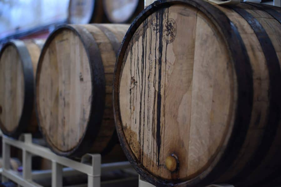 A buffer solution is used to maintain the ideal acidity range when fermenting wine