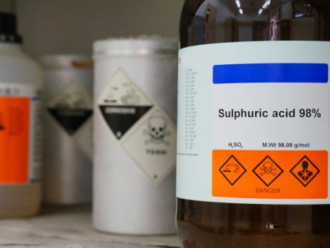 What is sulfuric acid? Bottle of sulphuric acid in a lab.