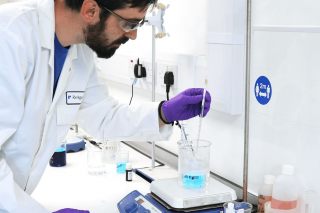 Lab technician doing sample analysis in ReAgent lab