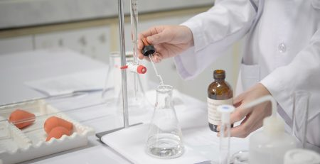 Scientist carrying out titration experiment in laboratory