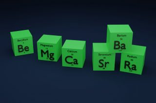 6 green cubes, each one bearing one of the alkaline earth metals
